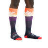 Image of a woman's legs on a white background wearing Women's Snowflake Over the Calf Midweight Ski & Snowboard Socks in Sunset