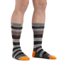 Man standing barefoot wearing Oxford Crew Lightweight Lifestyle Socks in Gray