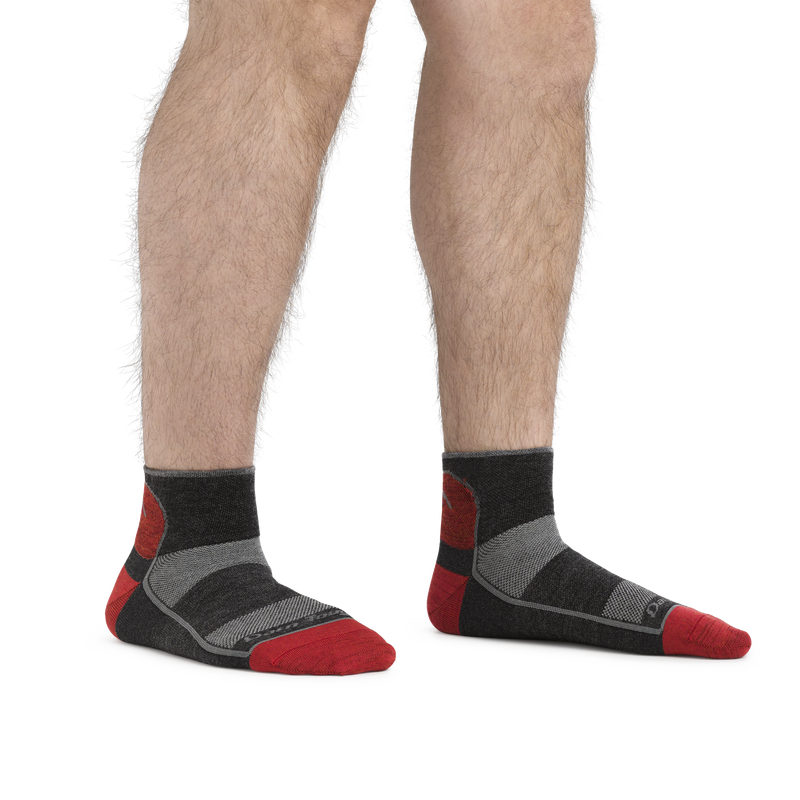 Man standing barefoot, wearing 1715 Quarter Lightweight Athletic Sock in color Team DTV, showing the quarter sock height hits just above the ankle.