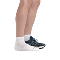 Profile image of male legs facing to the right wearing Run Quarter Ultra-Lightweight Running Socks in White with back foot also in a running shoe