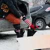Man sitting in the open back of a car, pulling on his Captain Stripe Over the Calf Ski & Snowboard socks and slipping into snowboard boots, Lifestyle Image
