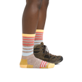 Profile image of a woman's legs on a white background, facing to the right, wearing Women's Gatewood Boot Midweight Hiking Sock in Oatmeal