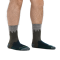 Man standing barefoot wearing Number 2 Micro Crew Hiking Socks in Green