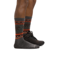 Profile of male legs facing to the right wearing VanGrizzle Boot Midweight Hiking Sock in Taupe with back foot in a hiking boot