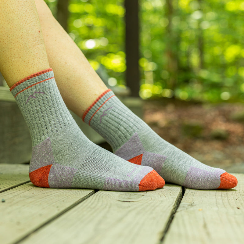 Close up image of a woman's feet on a wooden porch in the woods wearing Coolmax Hiker Micro Crew Midweight Hiking Socks in Light Gray, Lifestyle Image