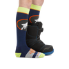 Profile image of kid legs facing to the right on a white background wearing Kids Powderhound Over the Calf Midweight Ski & Snowboard Sock in Eclipse with rear foot also in a snowboard boot