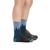 Profile image of a woman's legs on a white background wearing Women's Treeline Micro Crew Midweight Hiking Socks in Blue with one foot in a hiking boot