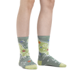 Image of a woman's legs on a white background wearing Women's Twisted Garden Crew Lightweight Lifestyle Sock in Green