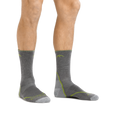 Man standing barefoot wearing Light Hiker Micro Crew Lightweight Hiking Sock in Gray