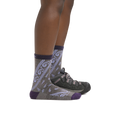 Profile image of a woman's legs on a white background wearing Women's Janis Micro Crew Midweight Hiking Sock in Taupe with a hiking shoe on one foot
