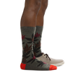 Profile image of male legs facing right wearing Haze Crew Lightweight Lifestyle Socks in Forest and a casual shoe on the foot in back