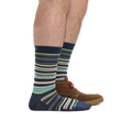 Man standing facing right, wearing Static Crew Lightweight Lifestyle socks in Midnight, back foot also wearing a brown boatshoe