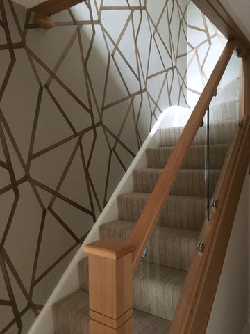 Glass and oak contemporary staircase with wallpaper