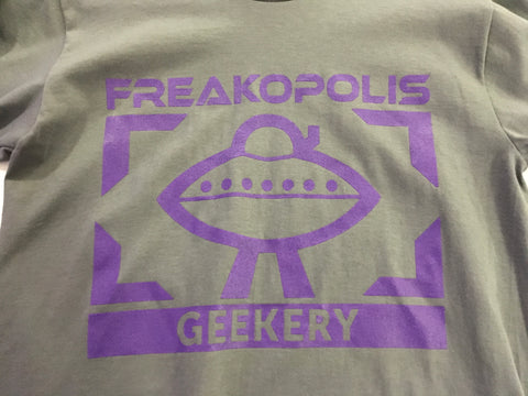 The Geekery UFO Logo printed on the chest of this T-Shirt