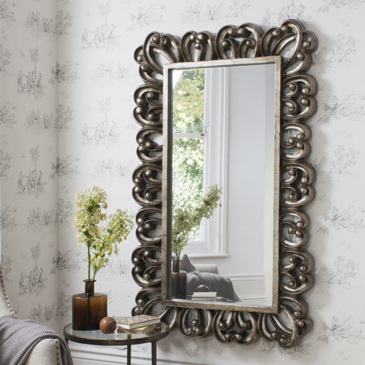 Stunning statement decorative frame in an antique silver finish Mirror.