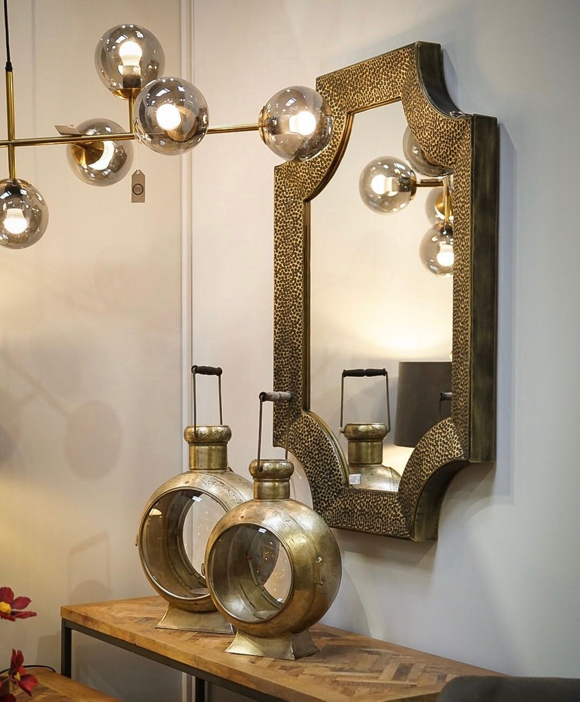 Stunnung shaped Mirror aged Bronze detailed
