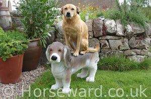 Betty sits on top of a beagle statue