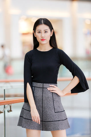 click to visit black color knitted top product page
