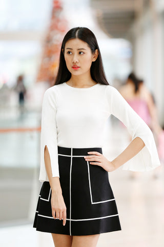 click to visit white color knitted top