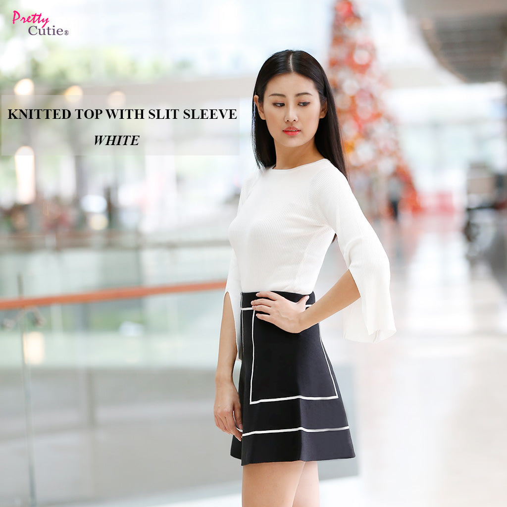 white round neck knitted top with slite sleeve main poster