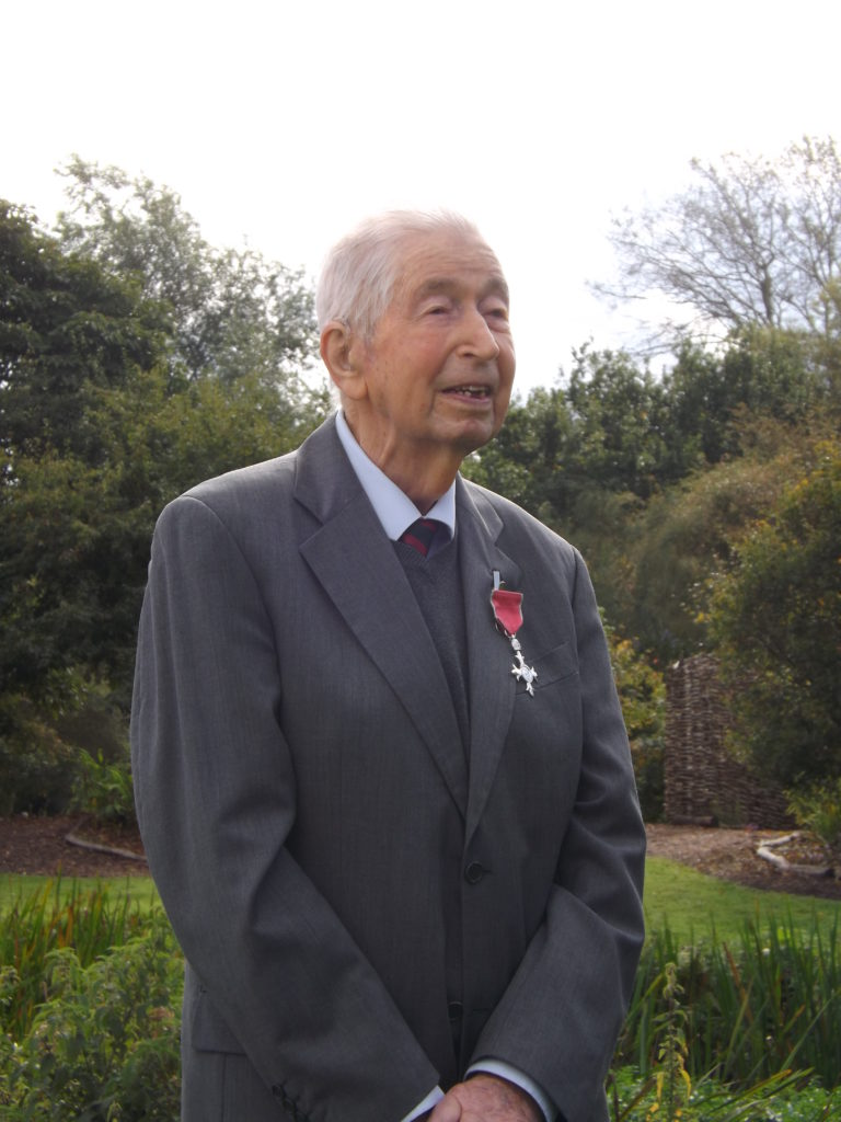 Bernard Tickner presented with MBE medal by Lord Lieutenant of Suffolk, at Fullers Mill Garden