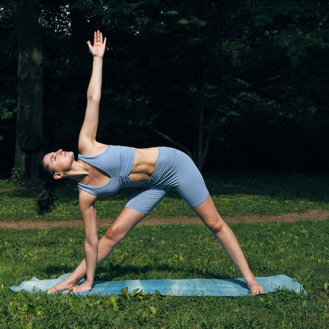 Kim Levin Fit Model yoga triangle pose in Central Park
