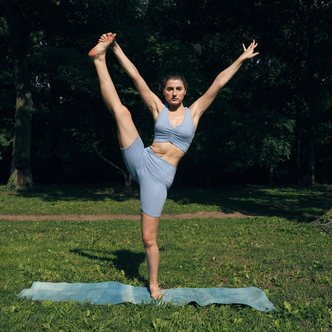 Kim Levin Fit Model yoga hand to big toe pose y stand in Central Park