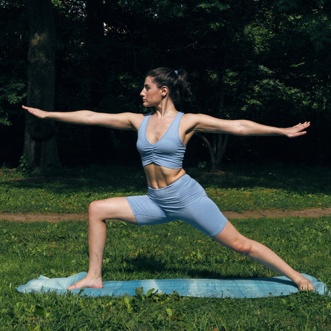 Kim Levin Fit Model yoga pose warrior 2 in Central Park
