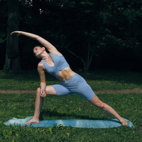 Kim Levin Fit Model yoga pose extended side angle in Central Park