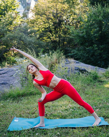 Kim Levin Fit Model red yoga pose extended side angle in Central Park