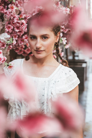 Kim Levin Fit Model in a white blouse with pink flowers in SoHo, NYC