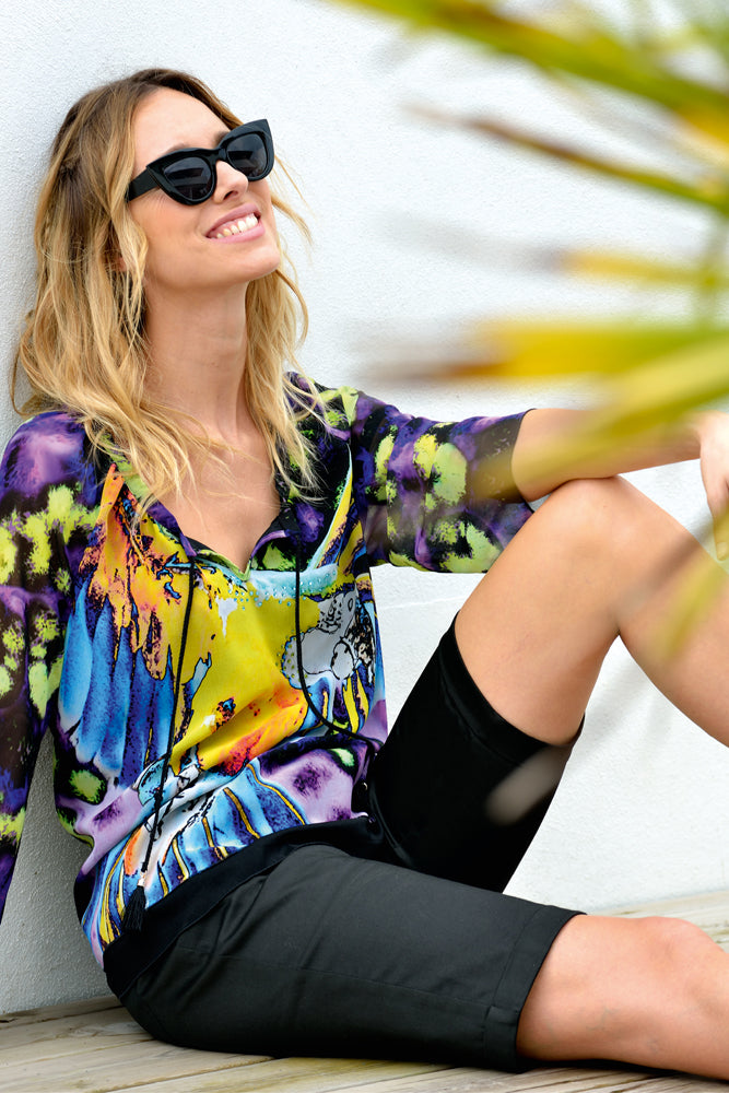 multi-coloured top with black shorts