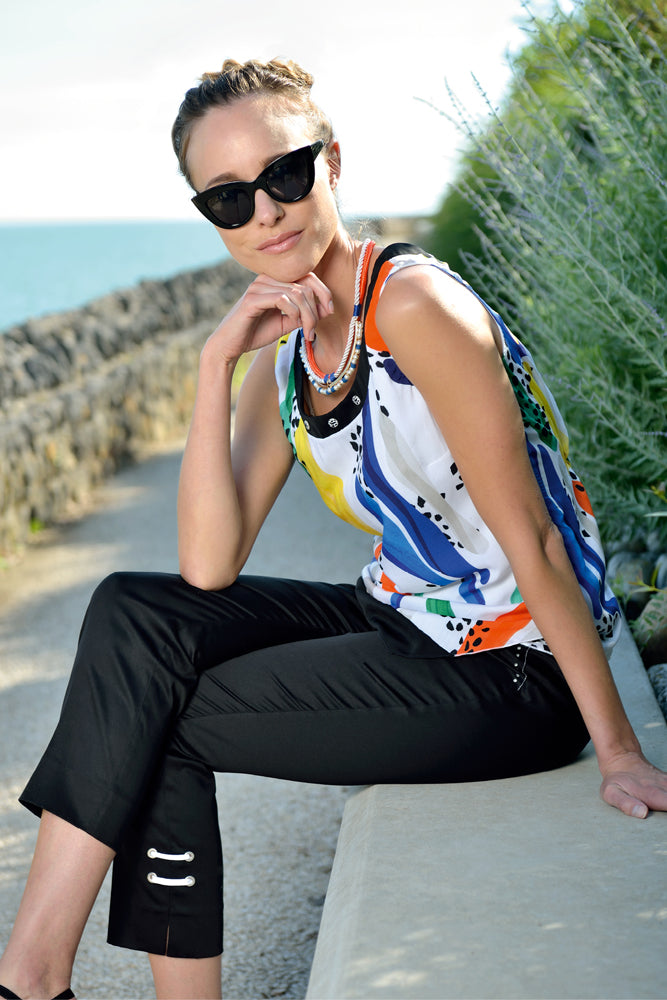 tank top with smart trousers and sunglasses