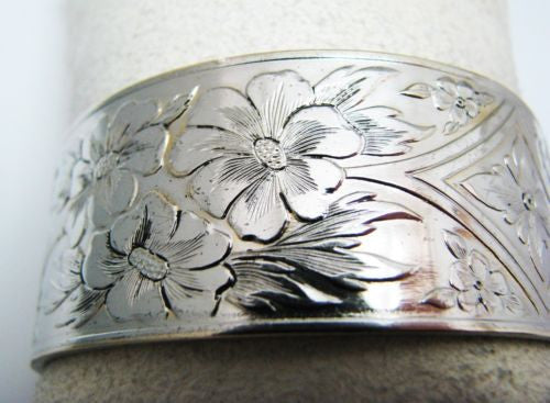 Pretty Wide Hinged Bangle with Safety Chain in Silver tone
