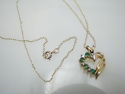 Lovely 10k Gold Emerald and Diamond Heart Shaped Necklace