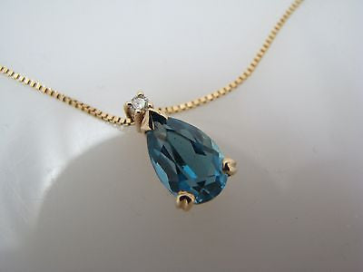 14k Yellow Gold Pear Shaped Blue Topaz Necklace with Small Diamond