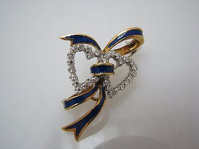 Beautiful Two Diamond Hearts Entwined with a Blue Enameled Ribbon Brooch