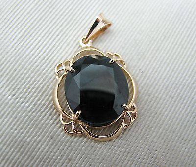 Black Oval Stone Set in a Lovely 14k Gold Filigree Mounting