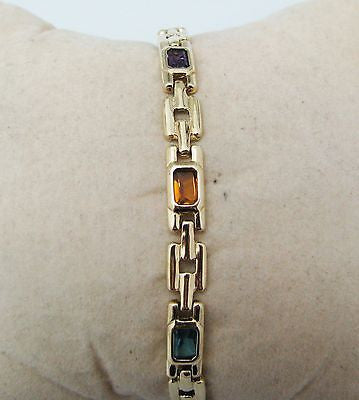 14k Yellow Gold Bracelet with Emerald Cut Gemstones