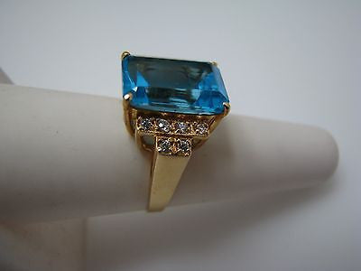 Stunning Emerald Cut Blue Stone Ring with CZ's