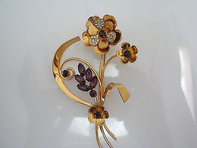 Pretty flower Brooch with Purple Stones and Clear Stones