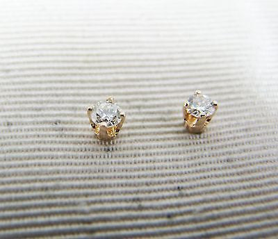 Pretty and Cute .14 Carat Diamond Stud Pierced Earrings in Yellow Gold