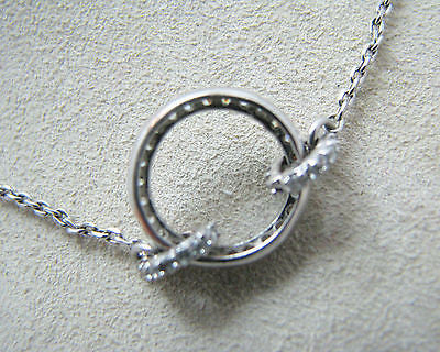 Lovely Sterling Silver Unbroken Circle Encrusted with Cubic Zirconias