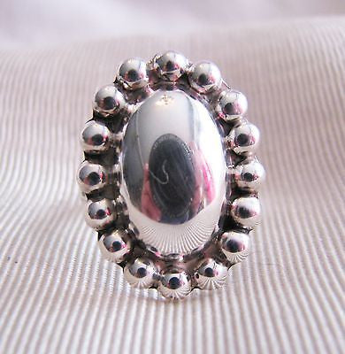 Sterling Silver Ring with a Large Oval Silver Medallion Surrounded by Beads