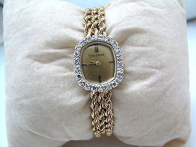 14 karat Yellow Gold Ladie's Watch with diamonds by Rene Pavol