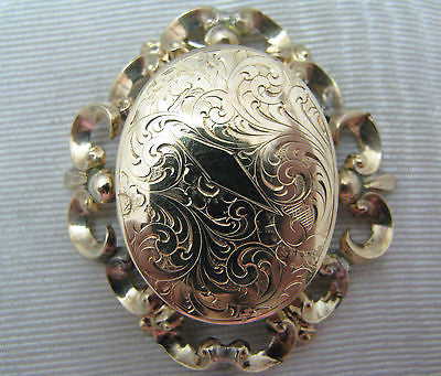 Gorgeous 14k Yellow Gold Memory Locket Surrounded by a Filigree Frame