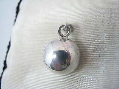 Simple Sterling Silver Ball with Something Inside to make it Tinkle