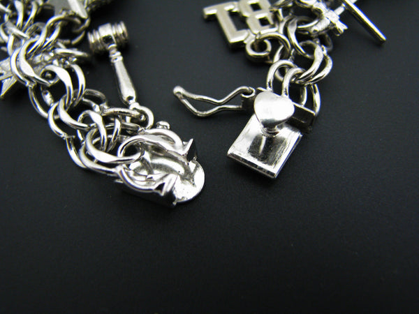 Beautiful Sterling Silver charm Bracelet with 18 Charms