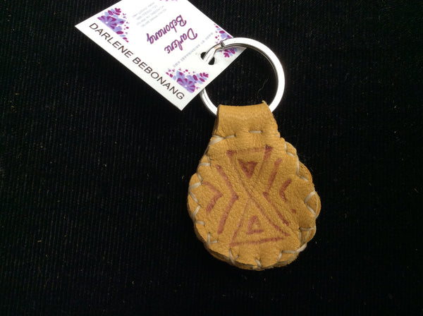 Burned design on leather keychain