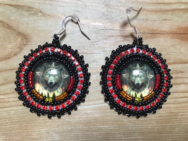Beaded earrings with Wolf cabs by Rachel Panamick - created offsite